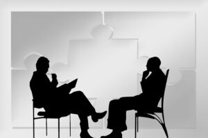 """A business analyst consultant talking to their client.  Image by <a href=""""https://pixabay.com/users/geralt-9301/?utm_source=link-attribution&utm_medium=referral&utm_campaign=image&utm_content=2204252"""">Gerd Altmann</a> from <a href=""""https://pixabay.com/?utm_source=link-attribution&utm_medium=referral&utm_campaign=image&utm_content=2204252"""">Pixabay</a>"""