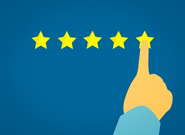 A finger selecting a five-star quality rating, indicating better value achieved when utilising a business analyst.