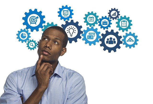 An image of a man thinking, or possibly innovating.